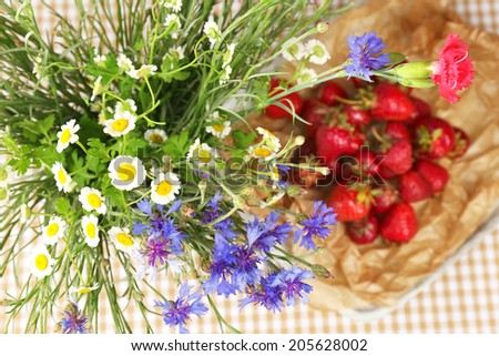 Beautiful wild flowers in vase on table - stock photo