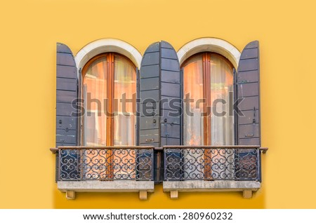 Beautiful window decorated with flowers in italy - stock photo