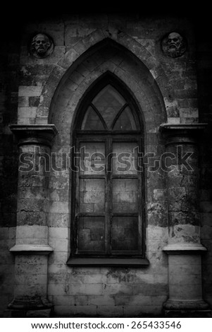 Beautiful window in the wall of a Gothic church - stock photo