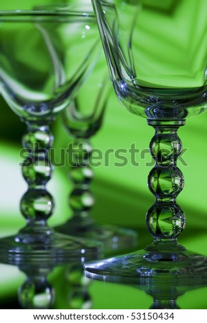 Beautiful wine glasses on abstract green background - stock photo