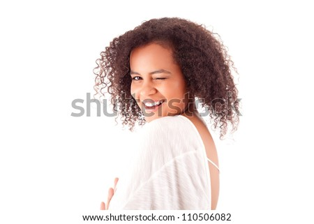 Beautiful winking young african woman - stock photo