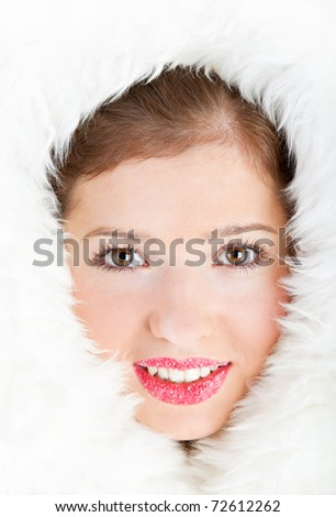 Beautiful winter girl is in the furs. Face is closeup - stock photo