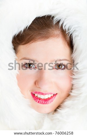 Beautiful winter girl is in the furs. Face is closeup