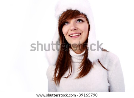 Beautiful Winter Girl looking away from camera