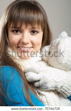 Beautiful winter girl with white teddy bear