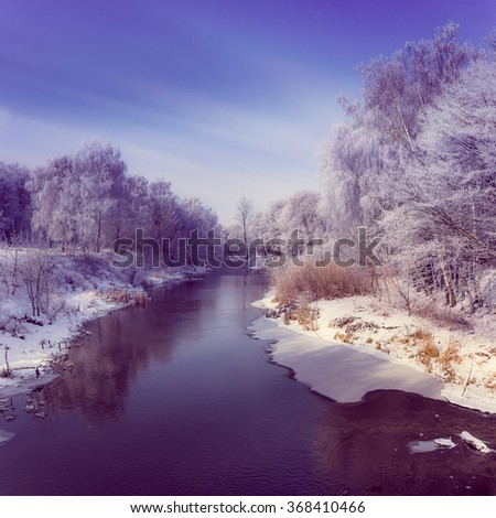 Beautiful winter landscape. View of  the river and frozen trees. Filtered image:cross processed instagram and soft focus effect.