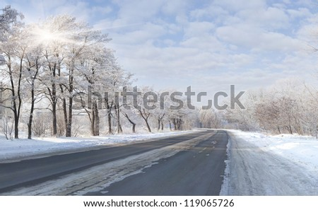 Beautiful winter landscape with a highway - stock photo