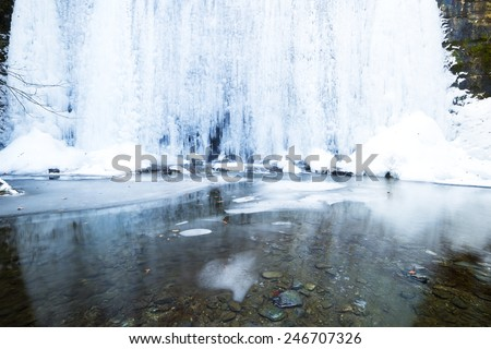 Beautiful winter landscape with frozen waterfall - stock photo