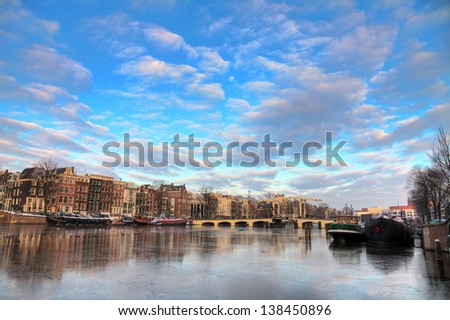Beautiful winter panorama of the river Amstel and the skinny bridge in Amsterdam, the Netherlands. HDR - stock photo