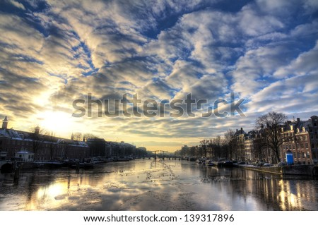 Beautiful winter panorama of the river Amstel in Amsterdam, the Netherlands. HDR - stock photo