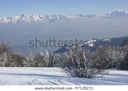 Beautiful winter scenery with view on Grenoble city from Plateau de Sornin, Vercors massif, near Grenoble, France - stock photo