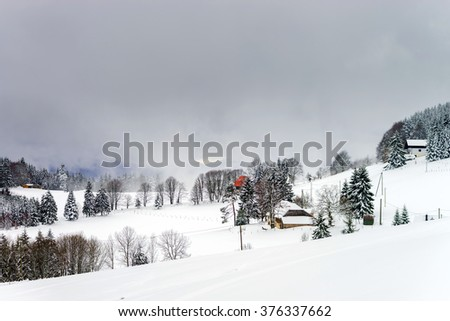 Beautiful winter snowy landscape with fog, alsacien mountains