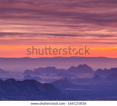 Beautiful winter sunrise in mountains and first light morning sunrise in nature - stock photo