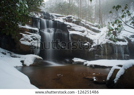 Beautiful winter waterfall in the Appalachian mountains of North Carolina - stock photo