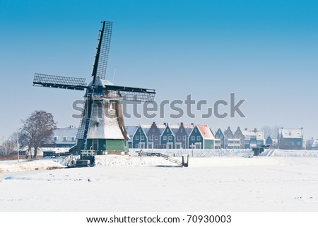 Beautiful winter windmill landscape in Volendam the Netherlands - stock photo