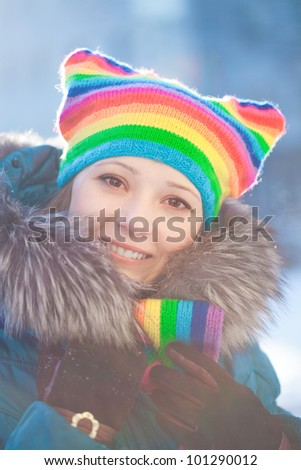 Beautiful winter woman in rainbow hat - stock photo