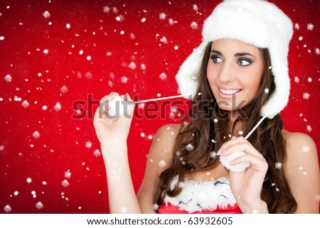 beautiful winter woman in santa costume and white furry hat - stock photo
