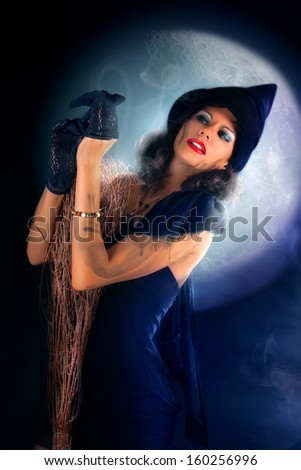 Beautiful Witch ready to fly - stock photo