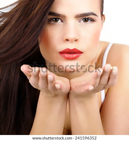 Beautiful with long brown hair woman blowing kisses. - stock photo