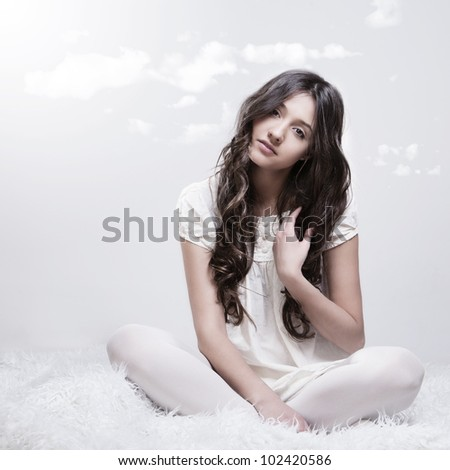 beautiful with perfect skin and hair in the morning in the clouds - stock photo
