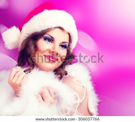 beautiful woman against colorful pink background, Christmas topic - stock photo