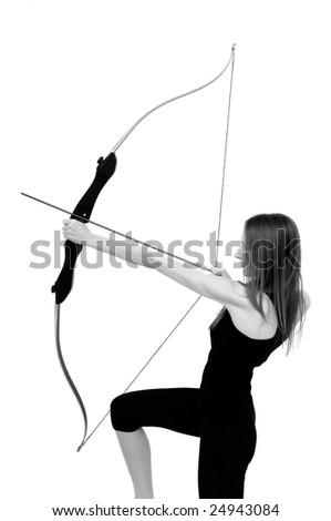 Beautiful woman aiming with bow - studio shot
