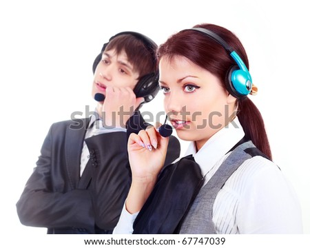 beautiful woman and a young man working in the call-center (focus on the woman)