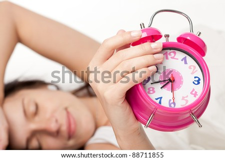beautiful woman  and alarm clock