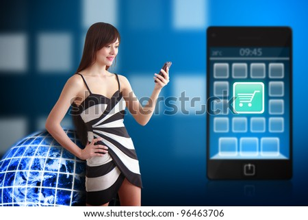 Beautiful woman and cart icon on mobile phone : Elements of this image furnished by NASA - stock photo
