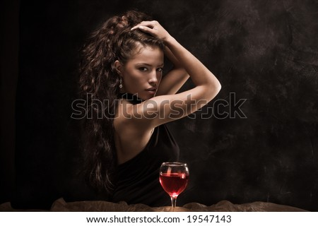beautiful woman and glass of wine - stock photo
