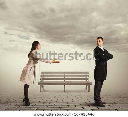 beautiful woman apologizing to man at outdoor - stock photo