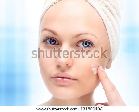 Beautiful woman applying moisturize cream in bathroom. - stock photo