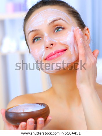 Beautiful Woman Applying Natural Homemade Facial Mask - stock photo