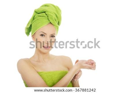 Beautiful woman applying perfume. - stock photo