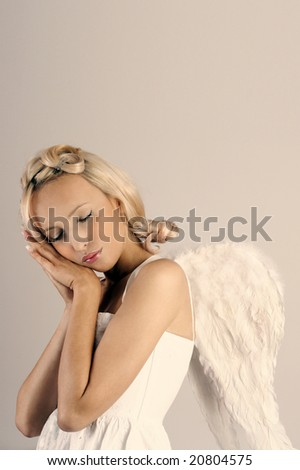beautiful woman as sleeping angel - stock photo