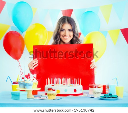 Beautiful woman at a birthday party holding a sign  - stock photo