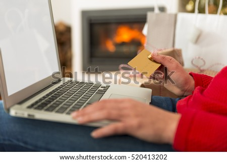 Beautiful woman at home and making  online shopping for Christmas