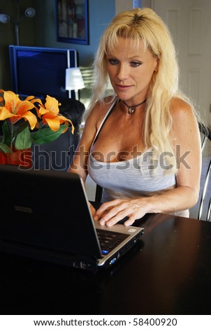 Beautiful Woman at Home On Laptop - stock photo