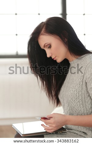 Beautiful woman at home with a tablet - stock photo
