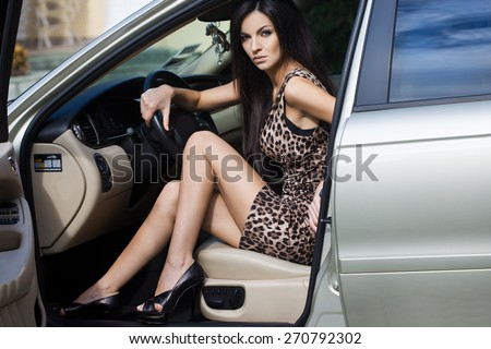Beautiful woman at the car - stock photo