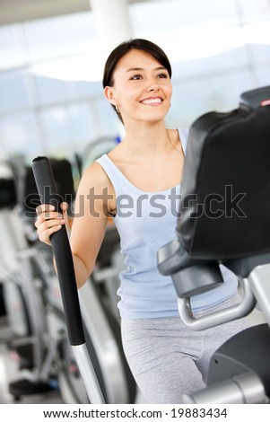 beautiful woman at the gym doing cardio exercise - stock photo