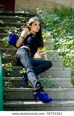 Beautiful woman at the stairs - stock photo