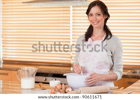Beautiful woman baking in her kitchen