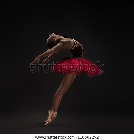 beautiful woman ballet dancer isolated on studio black background - stock photo