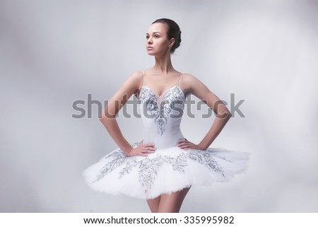 beautiful woman ballet dancer posing in studio - stock photo