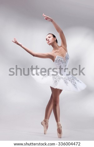 beautiful woman ballet dancer posing in studio