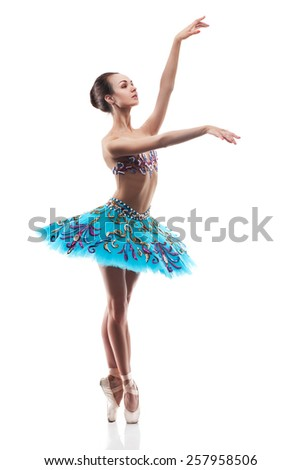 beautiful woman ballet dancer posing, isolated over white background - stock photo