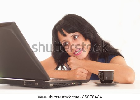 beautiful woman behind laptop on a white background