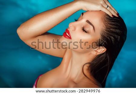 Beautiful woman bikini swimming pool summer vacation summertime sexy girl bikini fashion Vogue, tanned female model, girl having fun on beach, luxury lifestyle, series - stock photo