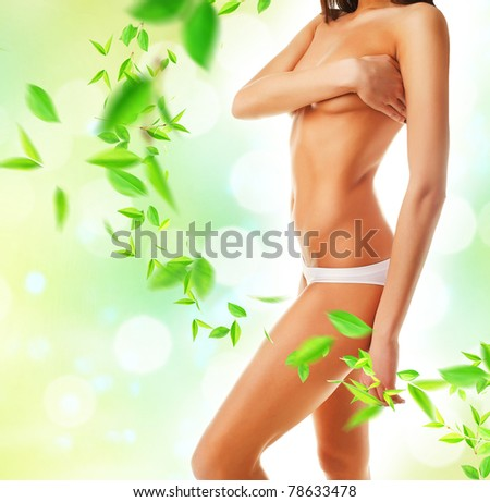 Beautiful woman body and leaves